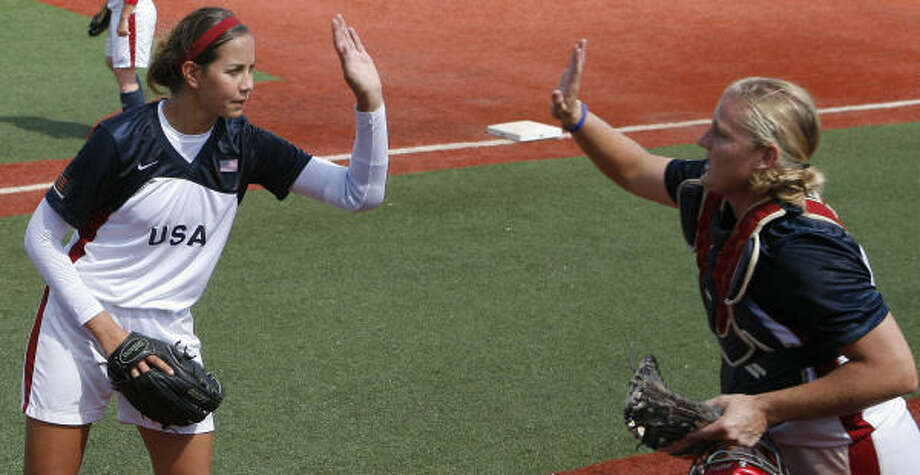 Cat Osterman (with former U.S. teammate Stacey Nuveman) allowed just 18 hits in her senior year of high school. Photo: Steve Campbell, Chronicle