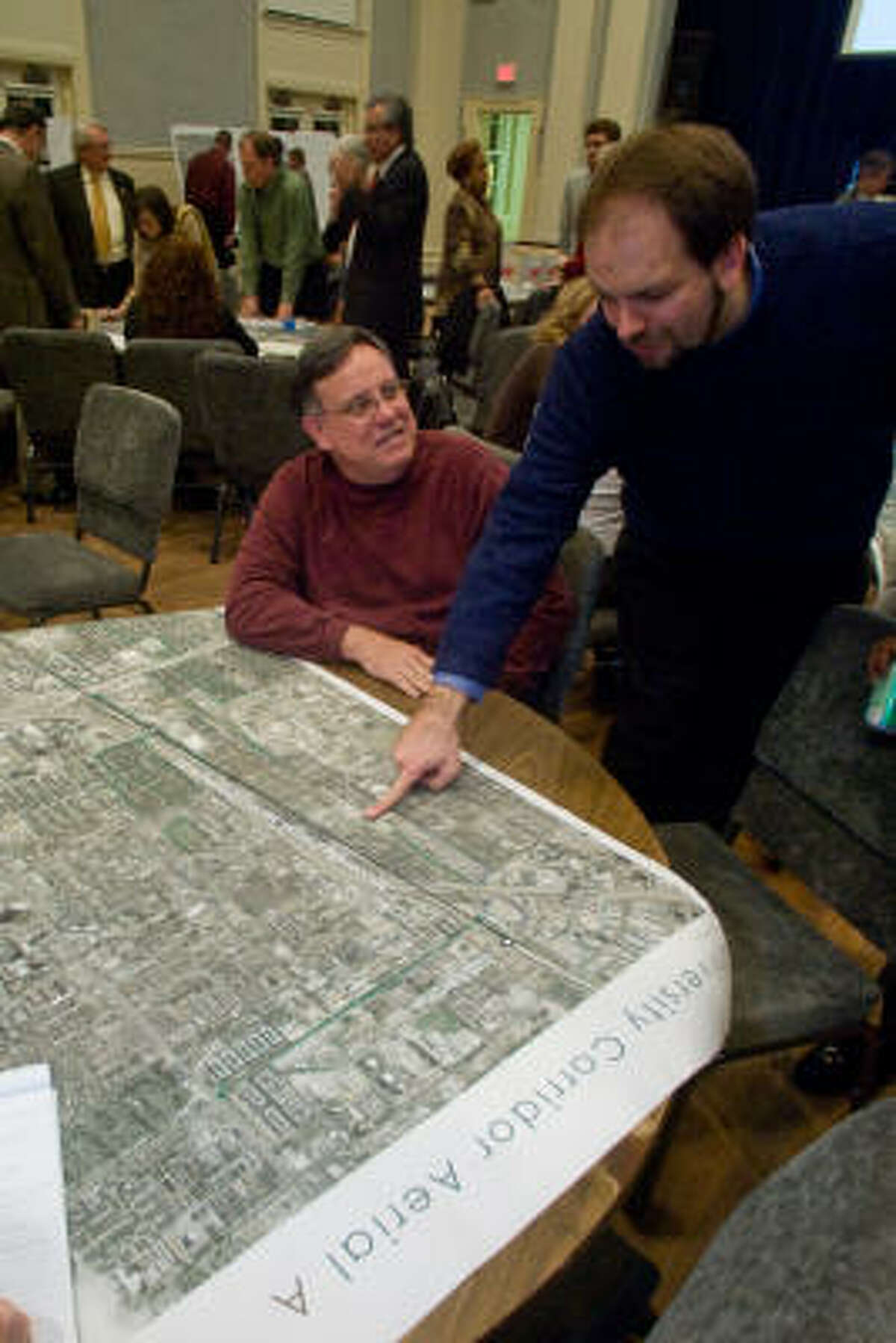 Area resident Mike McMahon, left, and Christof Spieler of the Citizens' Transportation Coalition, discuss development patterns.
