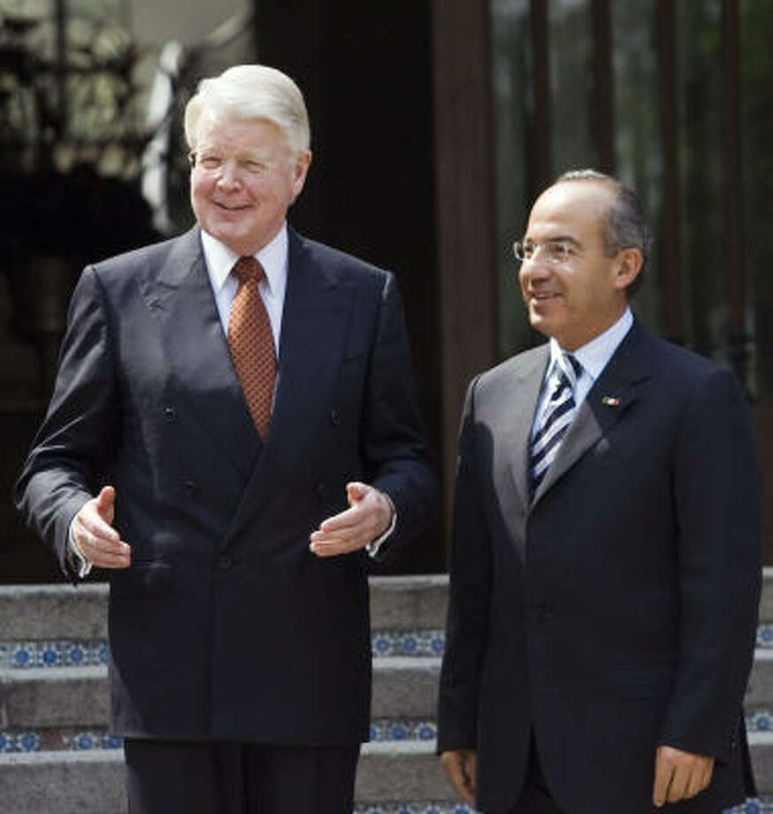 Mexico's President Felipe Calderon, right, listens to Iceland's President Olafur Ragnar Grimsson during the welcoming ceremony at the presidential residence of Los Pinos on Tuesday in Mexico City. Photo: RONALDO SCHEMIDT, AFP/Getty Images