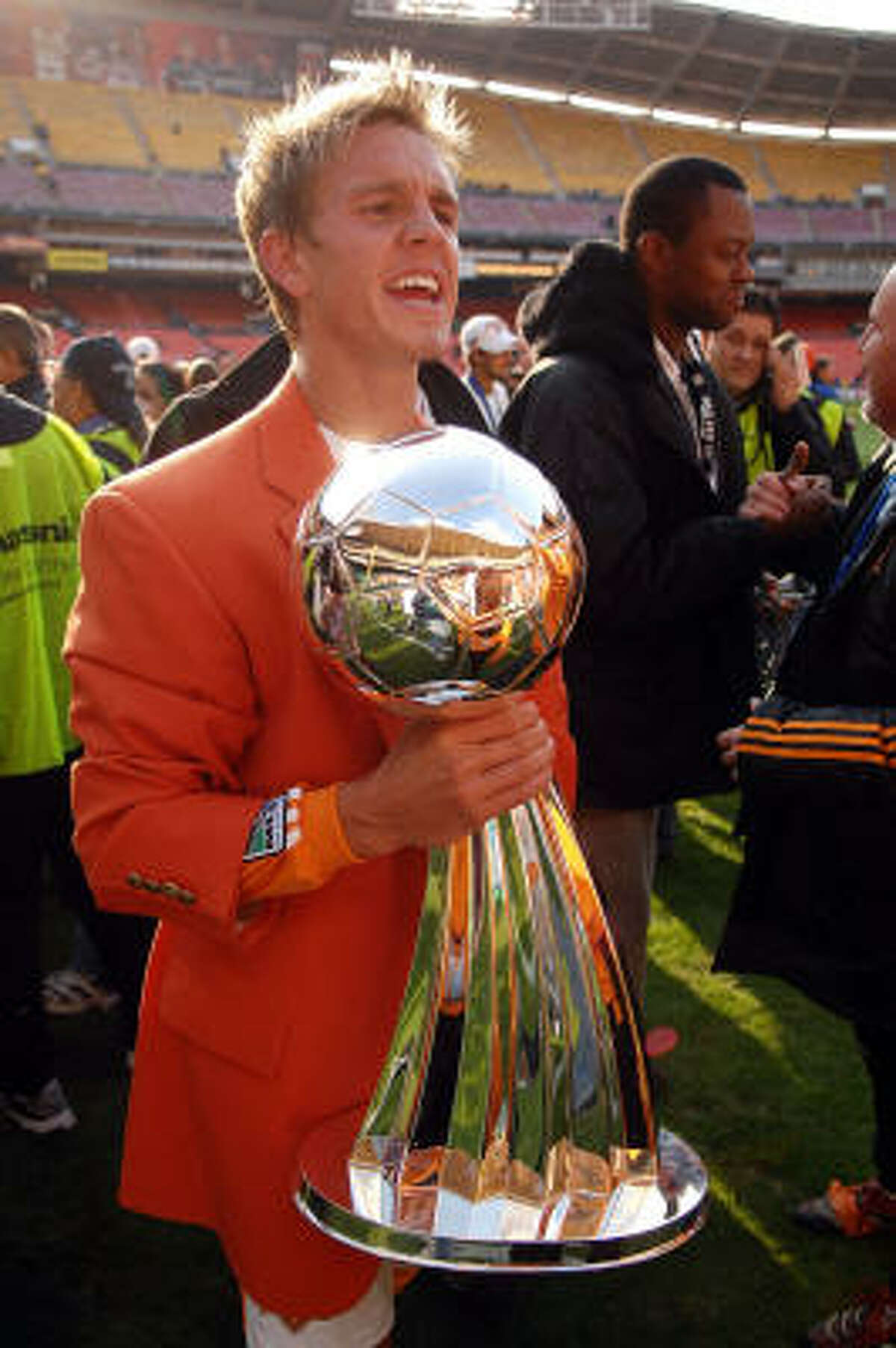 Stuart Holden (shown in 2007) took the MLS gold medal from around his neck — his Super Bowl ring, his World Series ring — and placed it on A.J.'s, columnist Richard Justice writes.