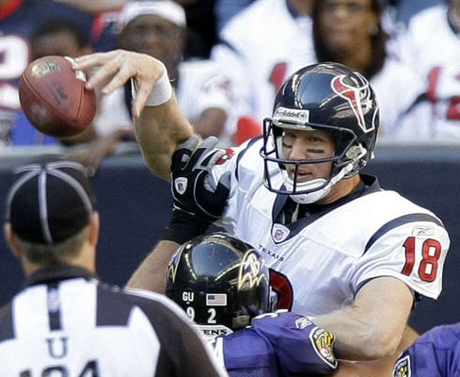 Texans quarterback Sage Rosenfels loses the handle on the football as he is hit by Baltimore's Haloti Ngata. Photo: Brett Coomer, Chronicle