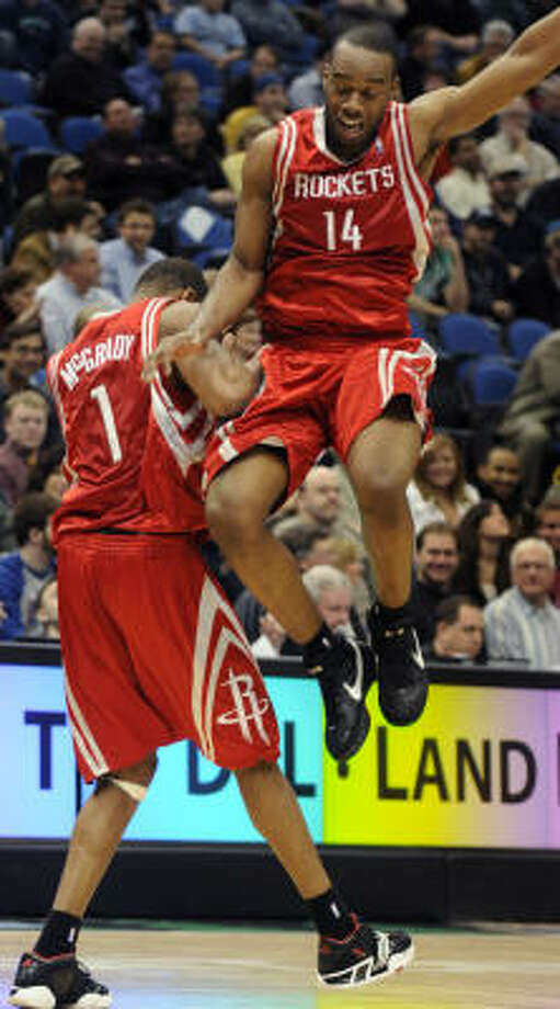 Rockets guard Tracy McGrady (right) and Carl Landry (14) celebrate after McGrady hit a three-point shot late during the fourth quarter that iced the game. Photo: Tom Olmscheid, AP