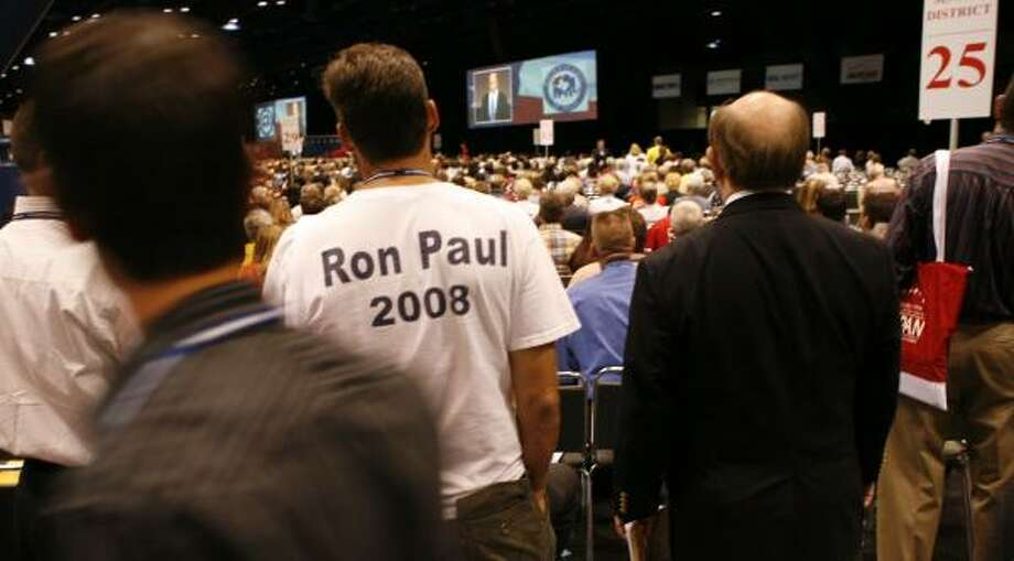 Ron Paul admirers can be found at the Texas Republican convention at the George R. Brown Convention Center. The congressman is scheduled to address the convention Saturday. Photo: STEVE UECKERT, CHRONICLE