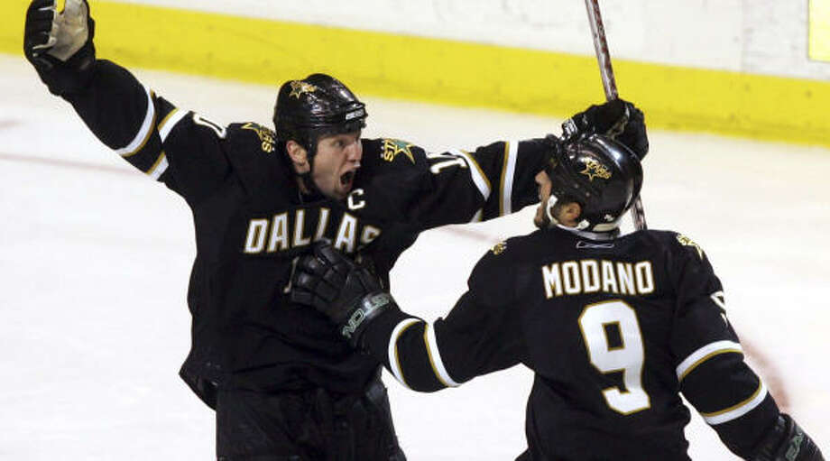 Stars forward Brenden Morrow, left, and teammate Mike Modano celebrate Morrow's game winning goal. Photo: LM Otero, AP