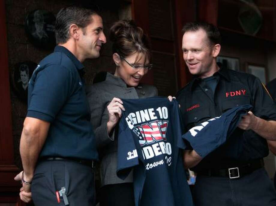 Vice-presidential candidate Sarah Palin meets firefighters Patrick O'Donnell, right, and John Morabito near the World Trade Center site. Photo: HENNY RAY ABRAMS, ASSOCIATED PRESS