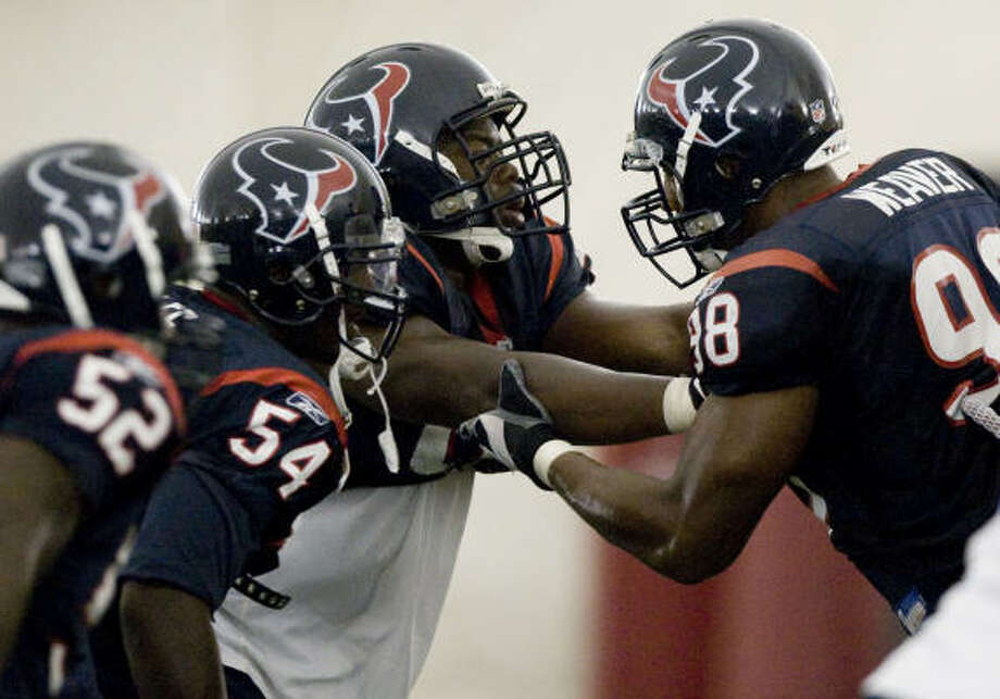 Texans defensive end Earl Cochran (96) blocks defensive end Anthony Weaver (98) as they go through pass rush drills. The two are competing for a a starting job at defensive end, opposite of Mario Williams. Photo: Brett Coomer, Chronicle