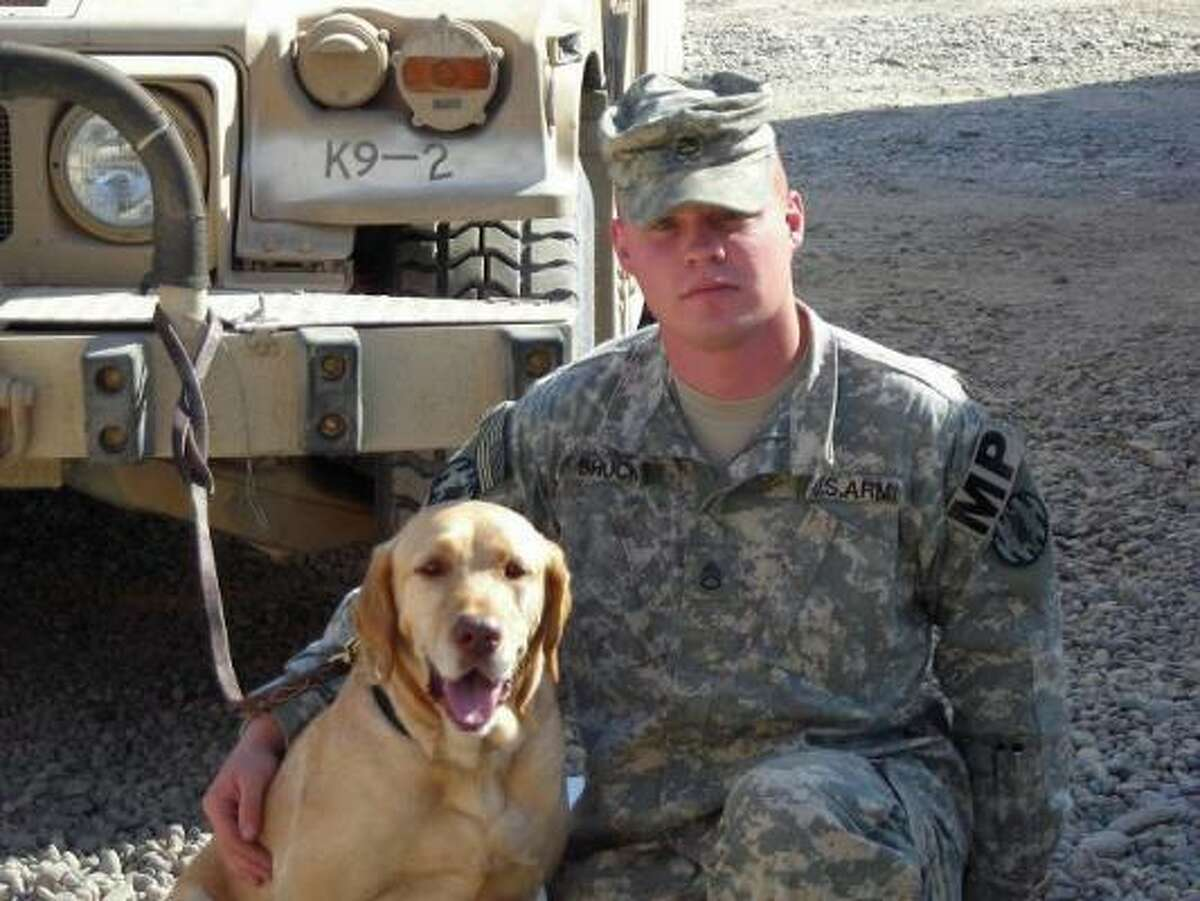 Staff Sgt. Charles Shuck and his dog, Stg. 1st Class Gabe in Iraq. Gabe was adopted out of a Harris County pound three years ago.