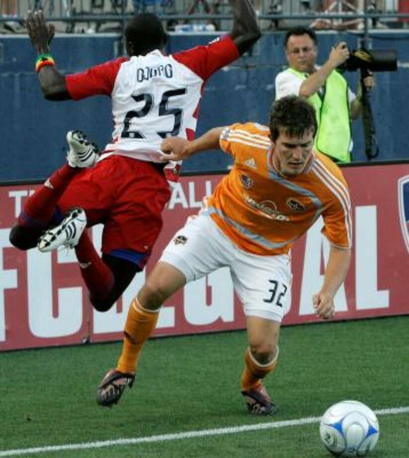 The recent play of defender Bobby Boswell (right) has been one of the bright spots for the Dynamo. Photo: TONY GUTIERREZ, ASSOCIATED PRESS