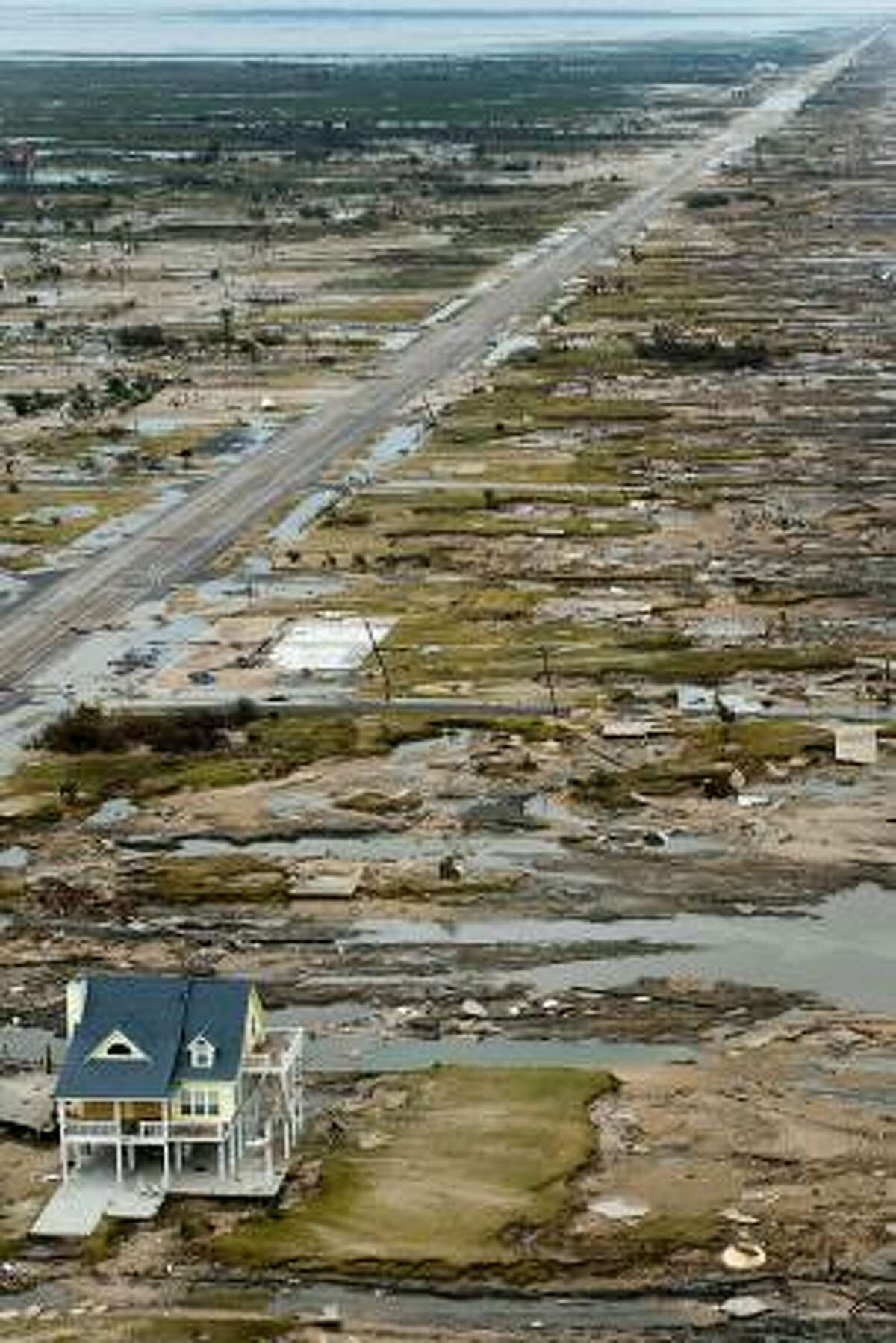 A single house is left standing Sunday in the aftermath of Hurricane Ike in the town of Gilchrist on the Bolivar Peninsula.