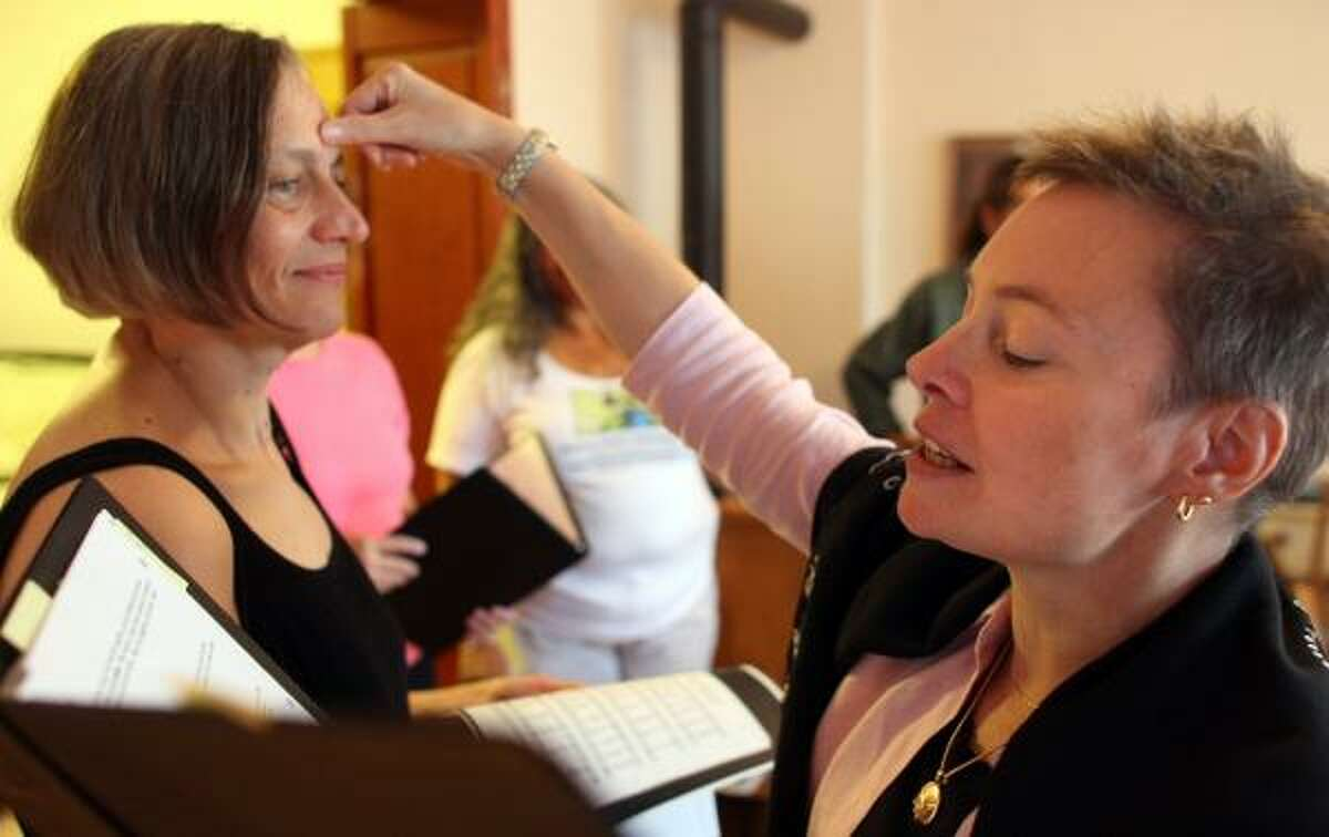 The Rev. Katherine Engel, right, performs a blessing ceremony in the home of Susan Snyder in Minneapolis. While home blessings are trendy, they aren't a new idea. They go back centuries.