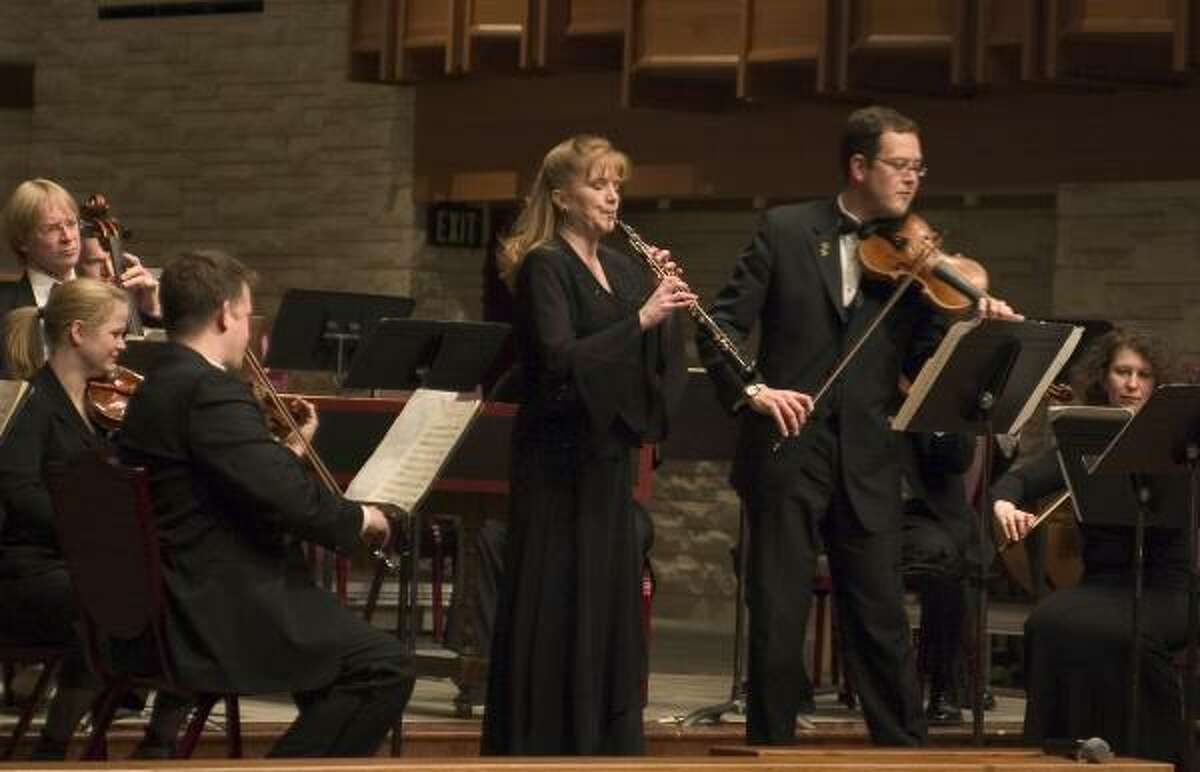 Alecia Lawyer, principal oboist/founder, and Brian Lewis, concertmaster, perform with the River Oaks Chamber Orchestra.