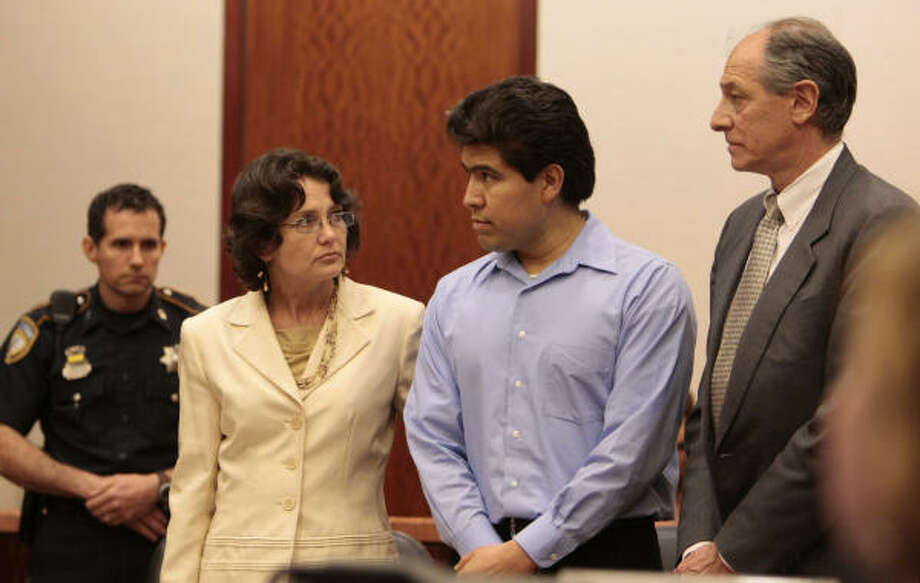 Juan Leonardo Quintero stands in court on May 8 between defense attorneys Danalynn Recer, left,   and David Lane as jurors announce their guilty verdict in his capital murder trial. The jury began considering his sentence today. Photo: Billy Smith II, Houston Chronicle