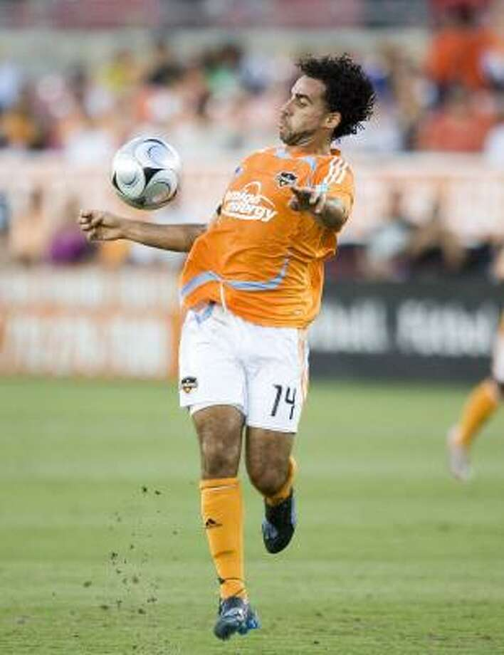 Midfielder/forward Dwayne De Rosario and the Dynamo look to break out of their MLS scoring funk in SuperLiga. Photo: BOB LEVEY, ASSOCIATED PRESS