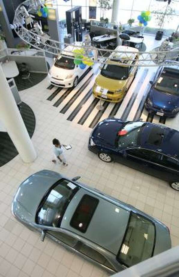 A Sales Consultant Walks Through The Fred Haas Toyota World Showroom In  Spring Earlier This Year