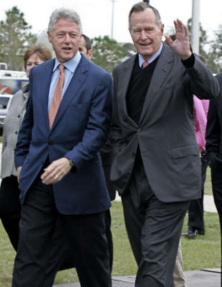 Former Presidents Clinton and Bush, shown in New Orleans for their Katrina relief effort in 2005. They're working together again to help the Gulf Coast after Ike. Photo: CHITOSE SUZUKI, Associated Press