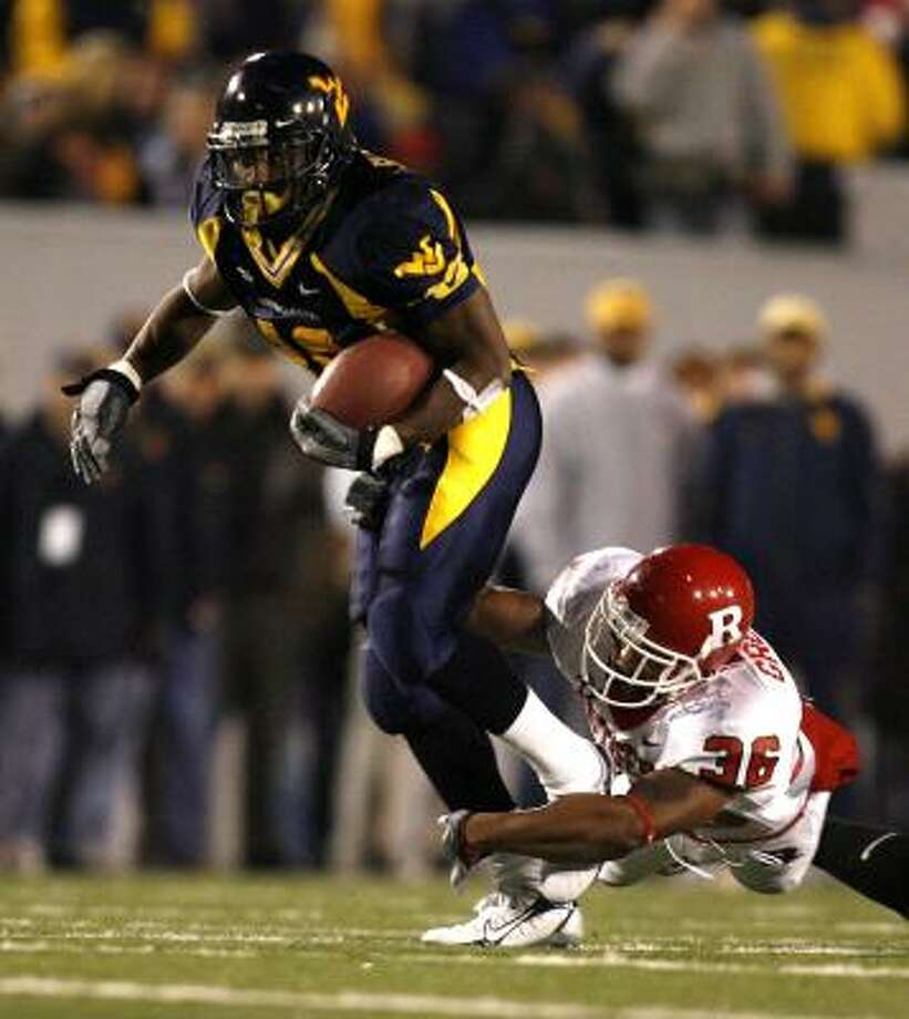 Steve Slaton Slaton (5-9, 197 pounds) had a prolific career at West Virginia, rushing for 3,923 yards in three seasons. Photo: Gregory Shamus, Getty Images