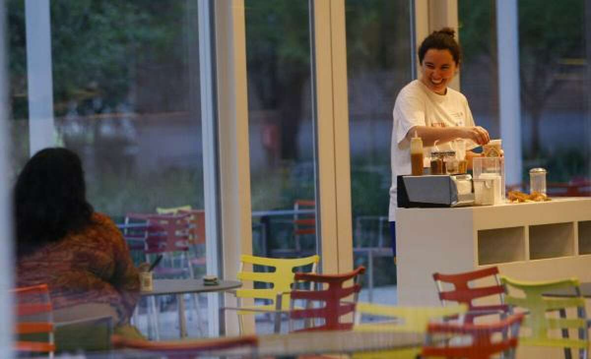 Ivana Peralta prepares coffee at the new Brochstein Pavilion at Rice University. The new building is a coffee shop and meeting place for students.
