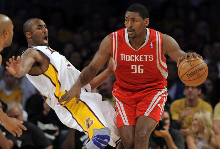Ron Artest moves past Lakers guard Kobe Bryant in the first half. Photo: Mark J. Terrill, AP