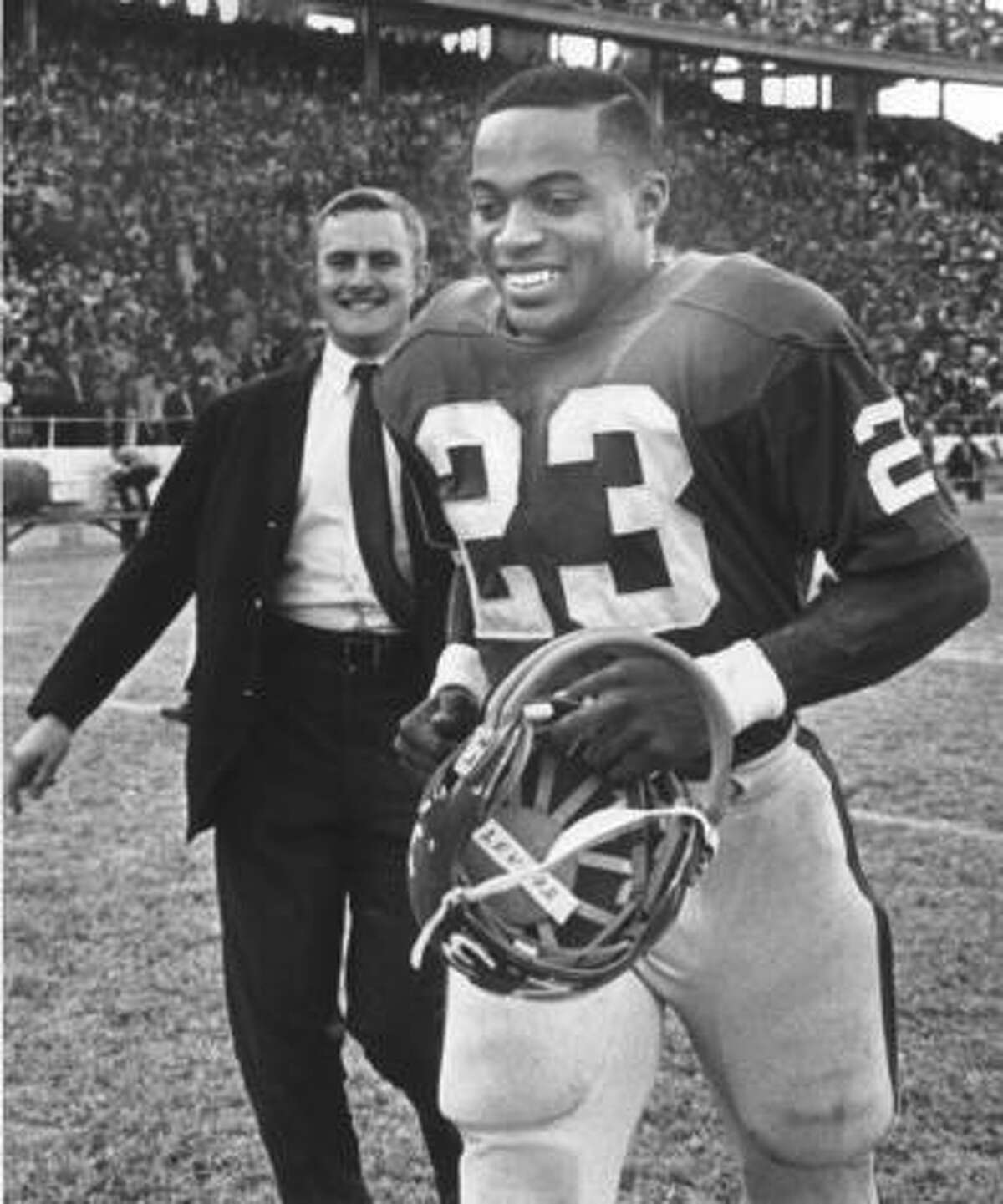 Southern Methodist player Jerry LeVias runs off the field at the Cotton Bowl in Dallas in this Nov. 5, 1966, file photo. LeVias broke the Southwest Conference color line in 1966, and he along with Hayden Fry, the coach who brought him to SMU in a time of racial upheaval, were inducted into the College Football Hall of Fame together.