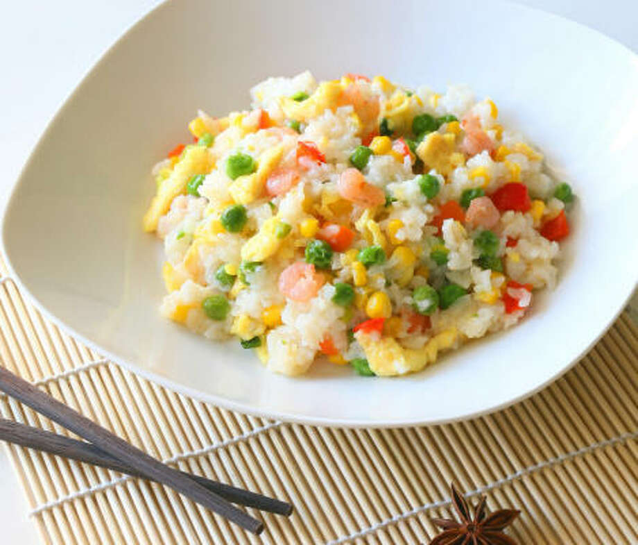Add shrimp and corn to Egg-Fried Rice for a more substantial dish. Photo: FOTOLIA