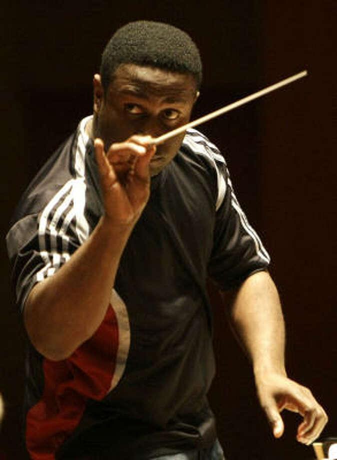 Kwamé Ryan, who will lead the Houston Symphony, rehearses with the orchestra at Jones Hall. Photo: Karen Warren, Chronicle