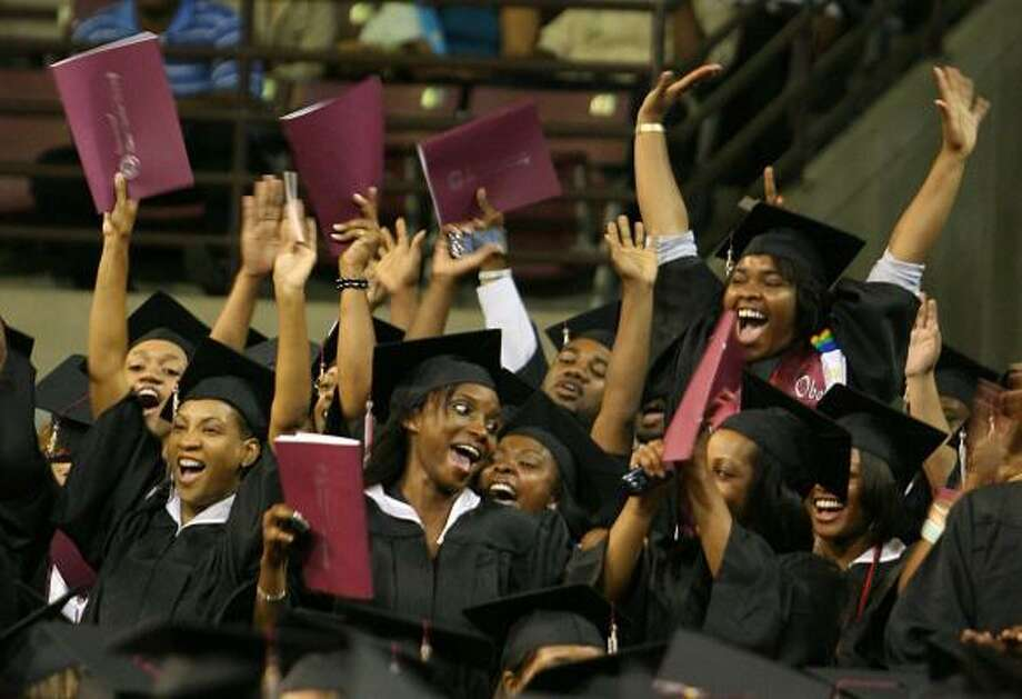 Graduating students from the Department of Science and Technology cheer as they are introduced during the TSU commencement ceremony on Saturday. More than 900 students received degrees from TSU this year. Photo: MAYRA BELTRÁN, CHRONICLE