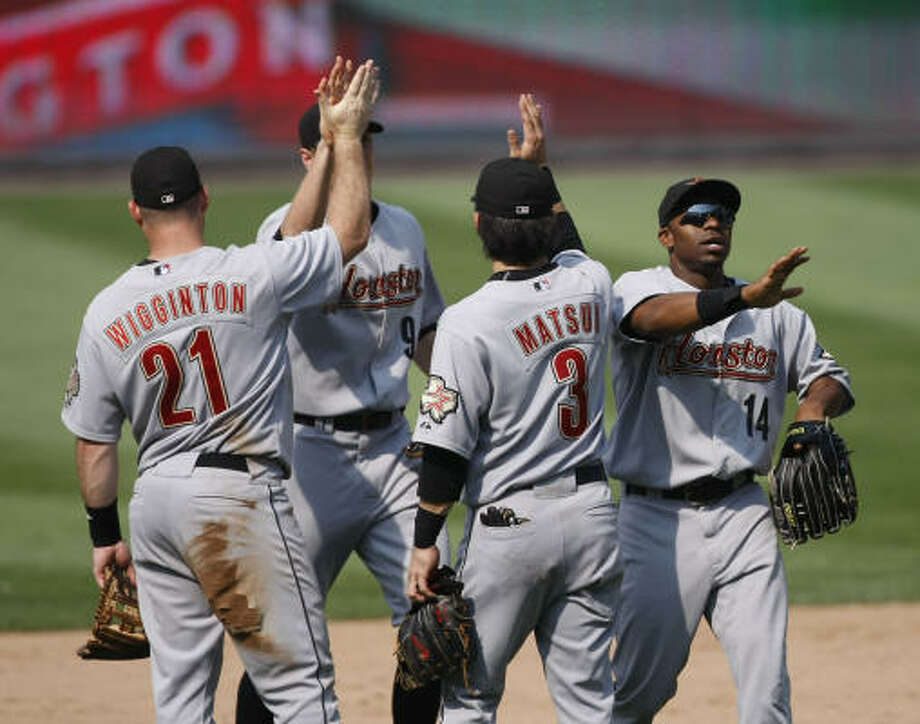 (From left): Ty Wigginton, Hunter Pence, Kazuo Matsui and Michael Bourn celebrate the end of a nine-game road trip with a series win over the Nationals. Photo: Pablo Martinez Monsivais, AP