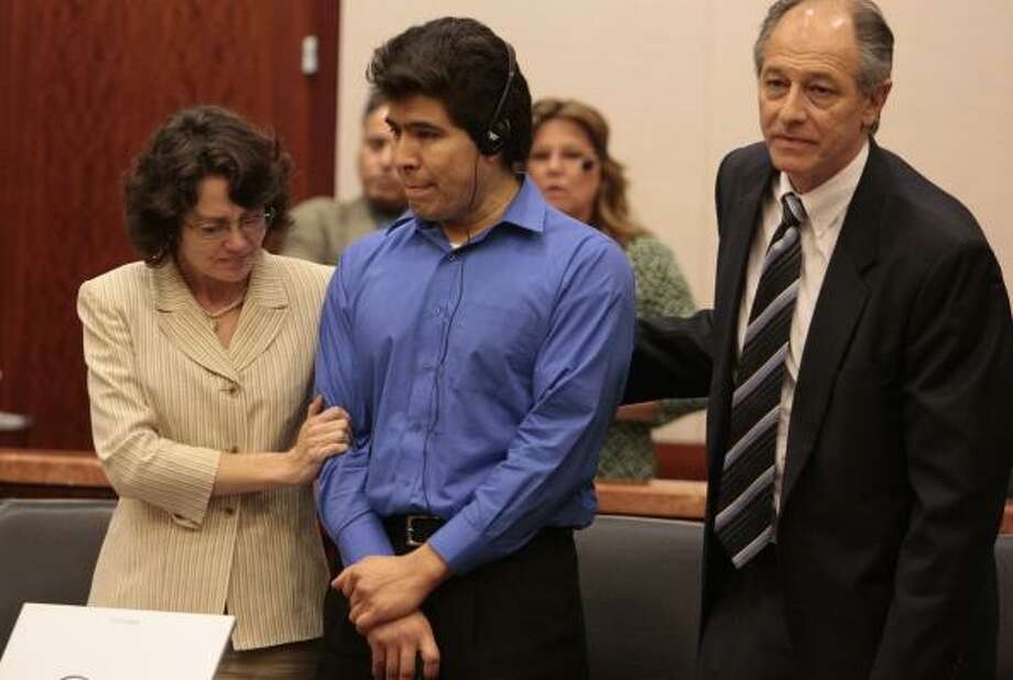 Flanked by defense attorneys Danalynn Recer and David Lane, illegal immigrant Juan Quintero listens Tuesday to a translation of his punishment for the 2006 slaying of HPD officer Rodney Johnson. Photo: BILLY SMITH II PHOTOS, CHRONICLE