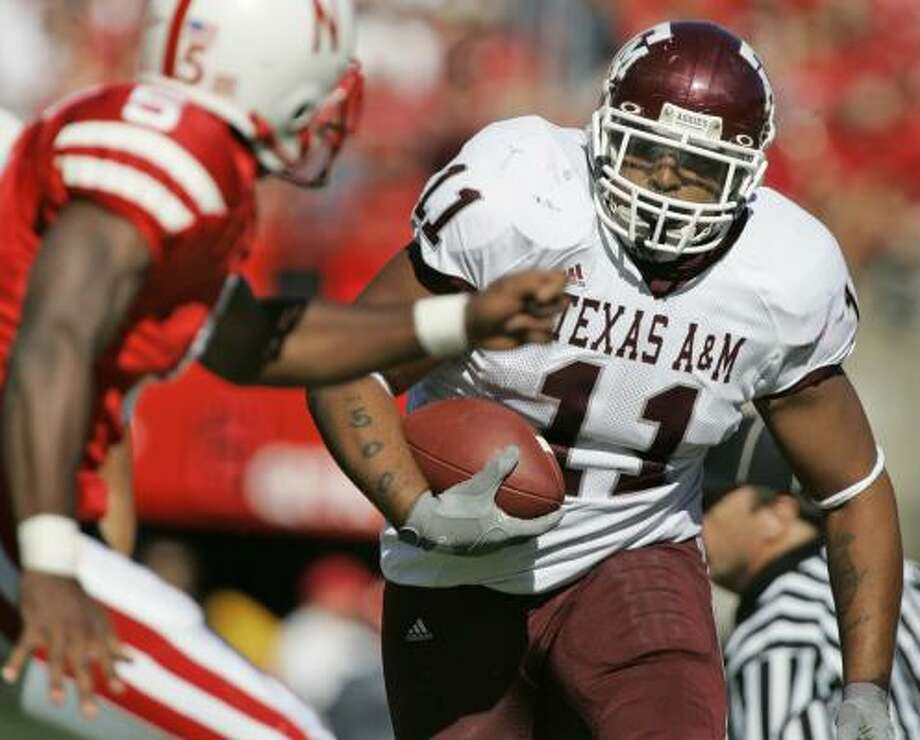 Texas A&M's Jorvorskie Lane (11) will switch from to fullback after being a primary ballcarrier for the past two seasons. Photo: Nati Harnik, AP
