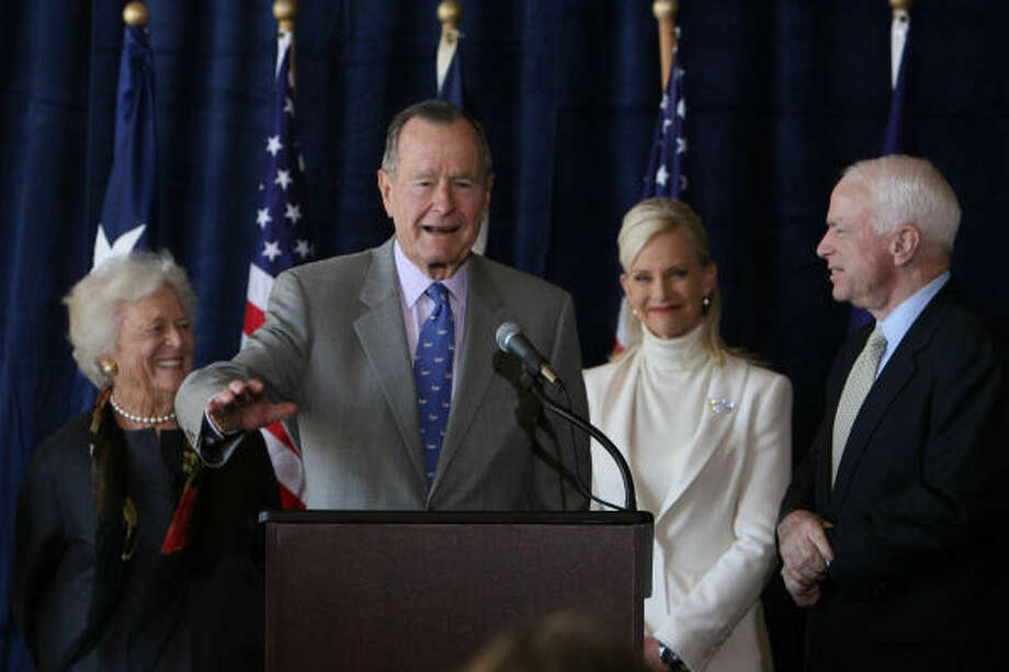 Former President Bush, center, endorses John McCain, far right, during a news conference today at Houston's Hobby Airport. At far left is Barbara Bush and to the left of McCain is McCain's wife Cindy. Photo: Sharon Steinmann, Chronicle