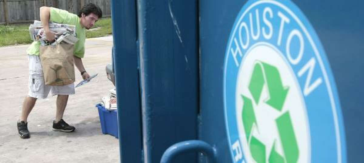 Murray Myers gathers paper and cardboard last week at the recycling center on Washington.