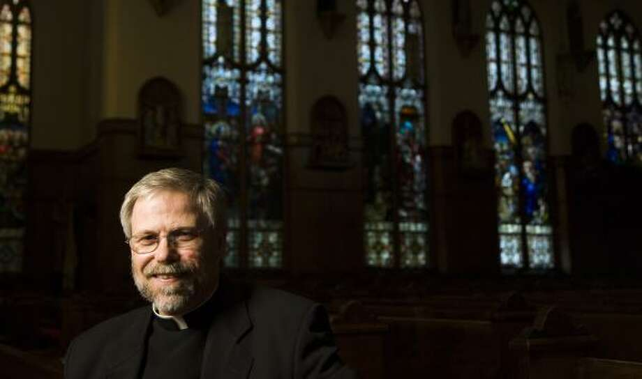 The Rev. R. Troy Gately, pastor of Houston's Co-Cathedral of the Sacred Heart, led fundraising for a Cathedral Center. He is being transferred to St. John Vianney Parish. Photo: SMILEY N. POOL, CHRONICLE