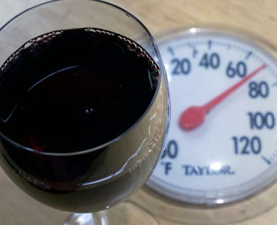 When the first wine drinker decided a red was best at room temperature, room temp wasn't what it is today. Photo: LARRY CROWE, ASSOCIATED PRESS