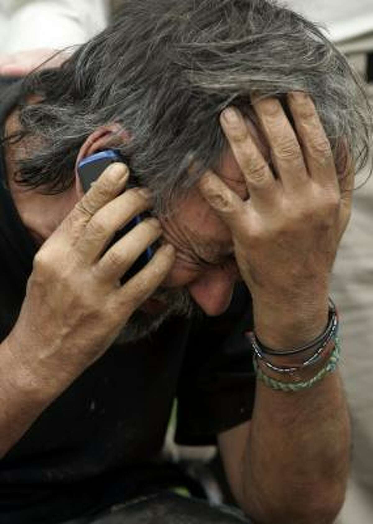 Oscar Tulio Lizcano, a former Colombian politician, makes a call Sunday after his escape from the FARC, which held him hostage for eight years.