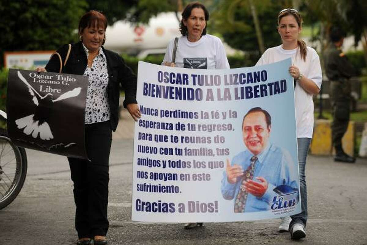 Oscar Tulio Lizcano's relatives gather in Medellin, Colombia, on Sunday upon hearing the news.