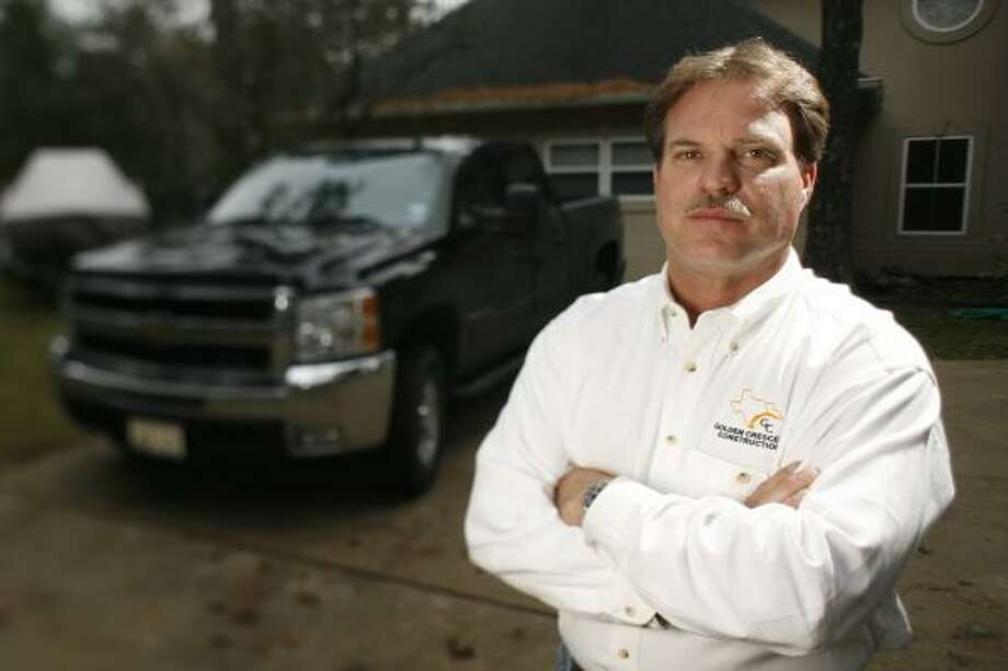 """Bill Christmann's new Chevrolet pickup sits where his previous Ford F-250, a vehicle preferred by narcotics and illegal immigrant smugglers, was stolen and taken to Mexico. He bought the Chevy for its diesel engine and because it has ''a lot better security on it."""" Photo: KEVIN FUJII, CHRONICLE"""