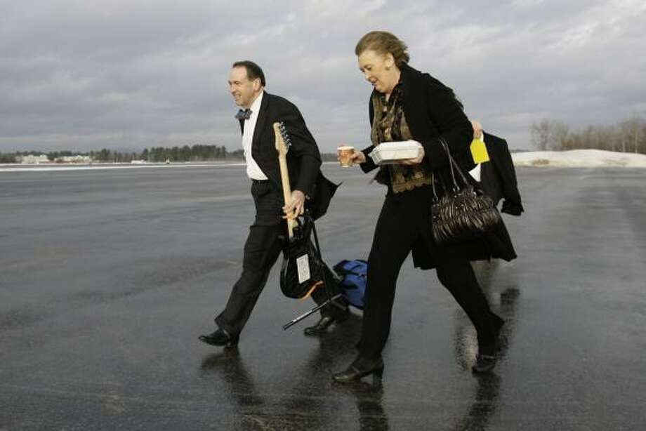 Former Arkansas Gov. Mike Huckabee and his wife, Janet, left New Hampshire on Wednesday for South Carolina, where the Republican is looking for support from religious conservatives. Photo: ALEX BRANDON, ASSOCIATED PRESS