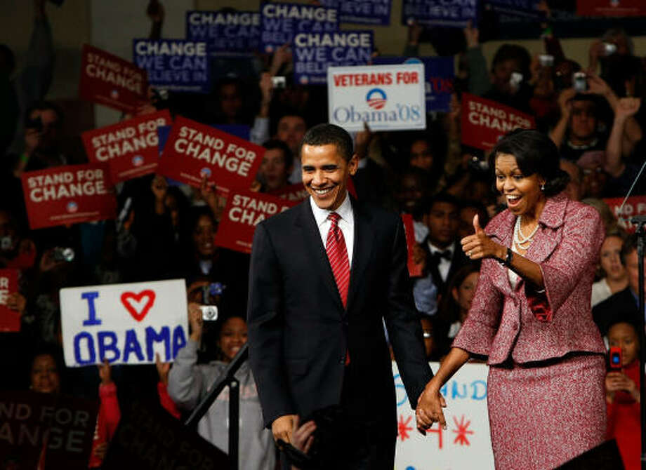 Democratic presidential candidate Sen. Barack Obama and his wife, Michelle, celebrate his resounding victory in the South Carolina primary with supporters at the Columbia Metropolitan Convention Center on Saturday in Columbia. Photo: Win McNamee, Getty Images
