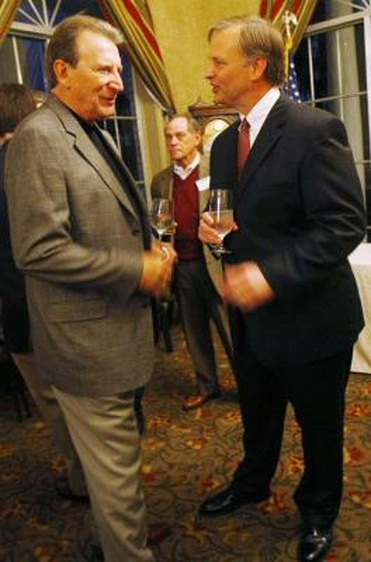 Hrbacek, right, talks to Joe Panozzo at a campaign fundraiser at the Sugar Creek Country Club on Thursday.