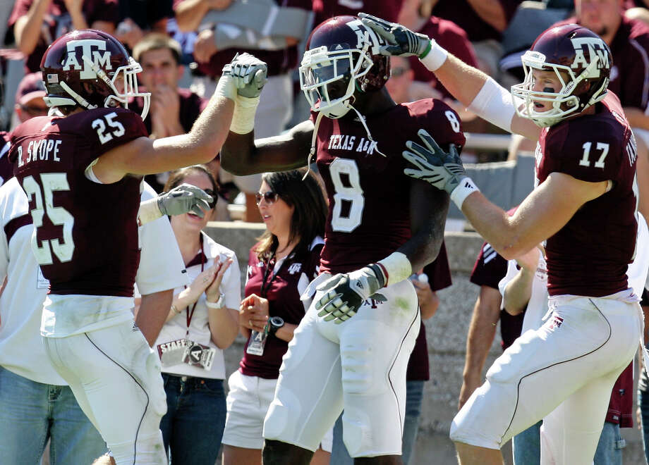 Senior Jeff Fuller (center), congratulated by teammates Ryan Swope (left) and Ryan Tannehill after scoring a touchdown in 2010, leads a receiving corps that should be one of Texas A&M's strengths this season. Photo: Edward A. Ornelas/eaornelas@express-news.net