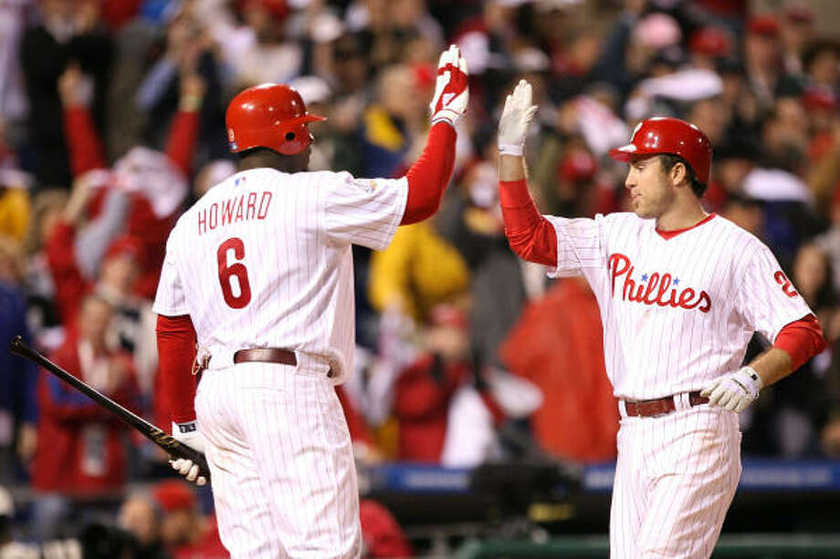 Chase Utley, right, is congratulated by Ryan Howard after hitting a home run in the sixth inning. Photo: Doug Pensinger, Getty Images