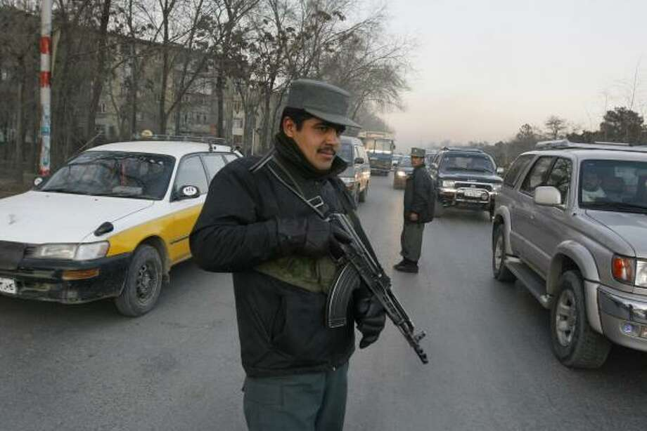 An Afghan police officer guards a checkpoint in Kabul. The Taliban target police, who don't travel in formations like the army. Photo: MUSADEQ SADEQ, ASSOCIATED PRESS