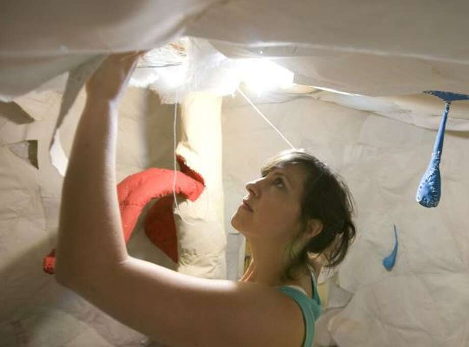 Riley works on her piece damaged by Ike. Photo: JAMES NIELSEN, CHRONICLE