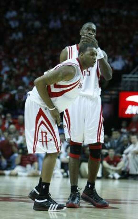 Rockets guard Tracy McGrady (left) and Dikembe Mutombo were a combined 8-for-24 from the field Saturday night in the Rockets' 93-82 loss tothe Jazz. Photo: Nick De La Torre, Chronicle