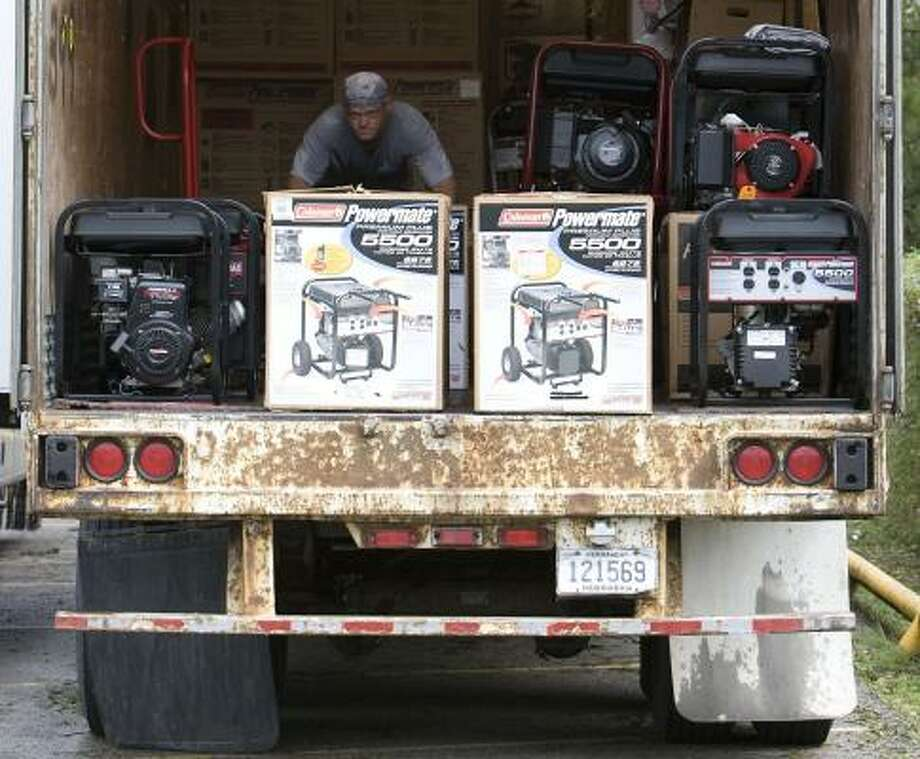 Curtis Tubaugh moves generators waiting to be sold in a semi trailer in Orange on Sunday. Memorial Hermann-The Texas Medical Center has handled more than 30 carbon monoxide poisonings. Photo: JAMES NIELSEN, CHRONICLE