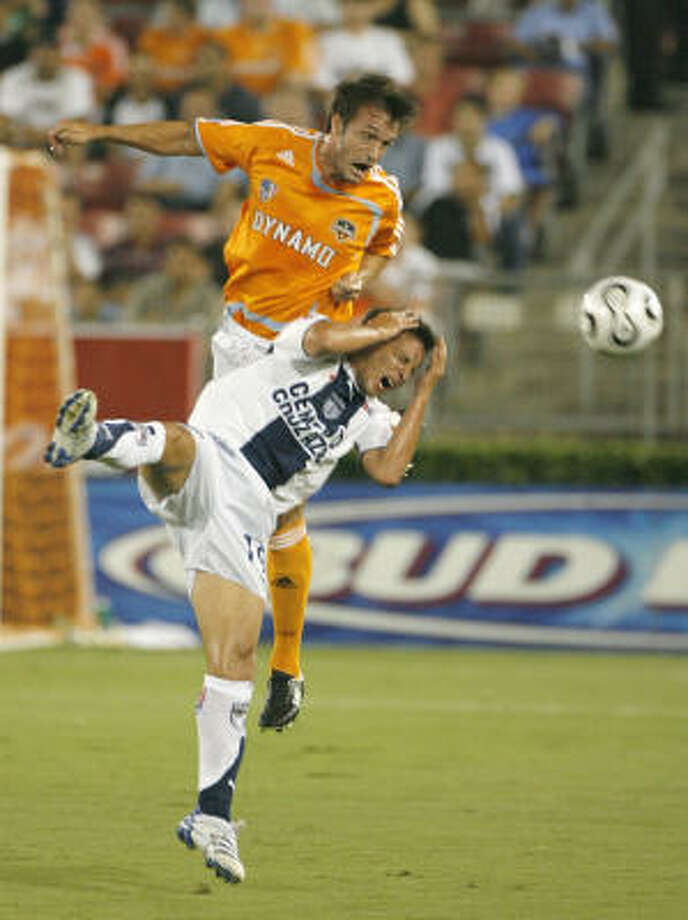 The Dynamo's Eddie Robinson (top) and Pachuca's Christian Gimenez both try for a header during a semifinal game in the 2007 SuperLiga Tournament. The Dynamo lost  5-4 in aggregate after overtime in Pachuca. They were eliminated from the 2007 CONCACAF Champions' Cup. They are seeking revenge Tuesday. Photo: Steve Campbell, Houston Chronicle