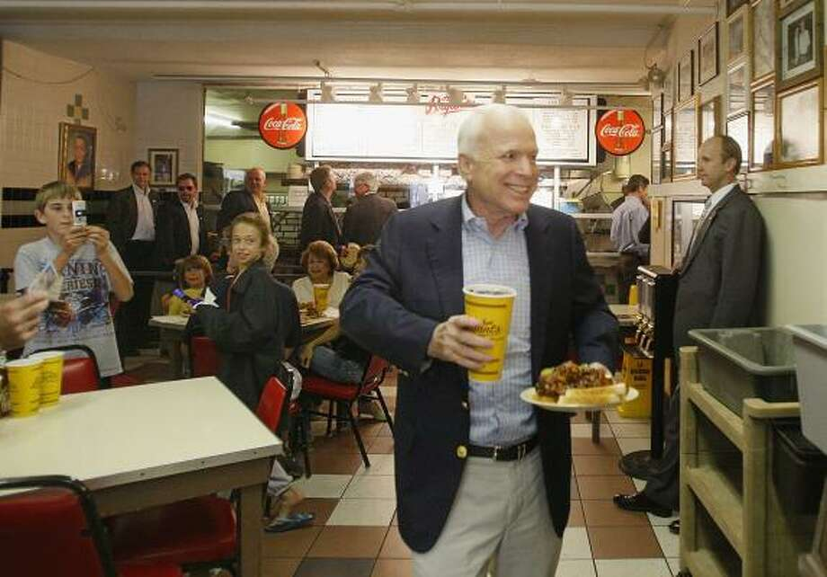 "CelebritiesCelebrities make ""pit"" stops at Kansas City barbecue joints. Here is Arizona Senator John McCain at Arthur Bryant's. Photo: STEPHAN SAVOIA, ASSOCIATED PRESS"