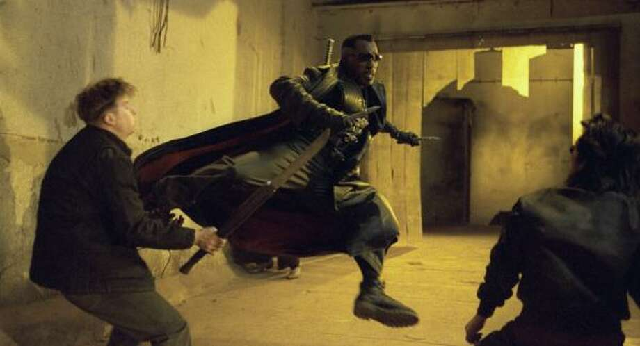 Actor Wesley Snipes, shown battling vampires in a scene from Blade II, was convicted on three misdemeanor counts of failing to pay income taxes. He faces up to three years in prison and could also be forced to pay millions in back taxes and penalties. The ranks of tax deniers are growing, and the Justice Department is cracking down. Photo: BRUCE TALAMON, NEW LINE CINEMA