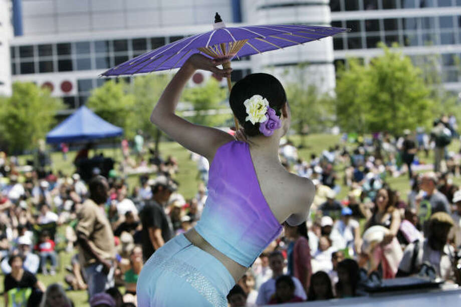 An Asian dancer performs during the opening of Houston's first major downtown park, Discovery Green, on Sunday. Photo: Eric Kayne, Chronicle