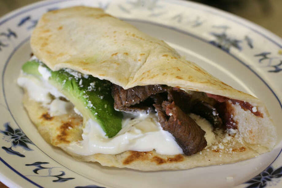 Las Hamacas' Baleadas Especiales consist of flour tortillas with steak, cotija cheese and avocado. Photo: Mayra Beltran, Houston Chronicle